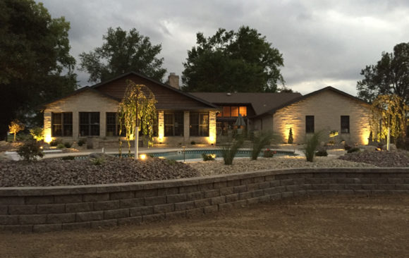Retaining wall with landscape lighting